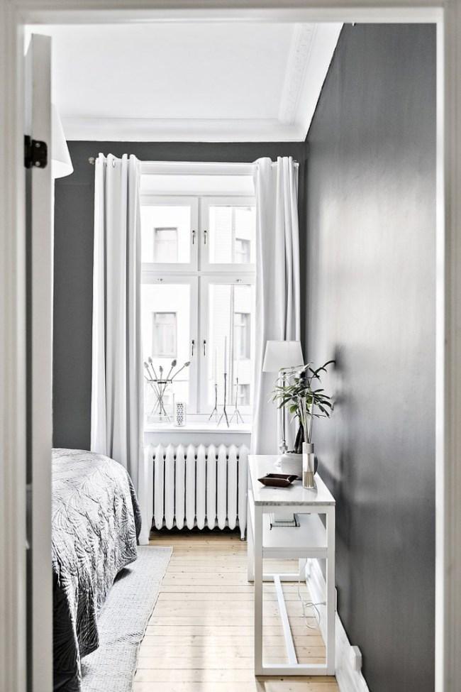 pinta la pared en tonos oscuros si tienes muebles claros
